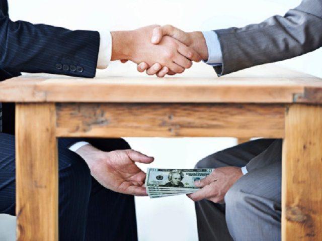 2078959374_Pic-of-Bribery-corruption-money-under-table securetherepublicdotcom